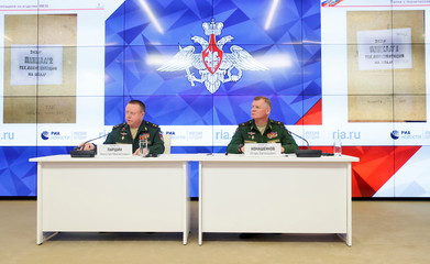 Russia's Major-General Konashenkov and Lieutenant-General Parshin attend a news conference on the crash of the Malaysia Airlines plane operating flight MH17 in Moscow