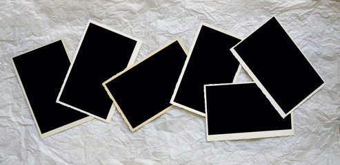 old empty photo frames, vintage blank photo prints on crumpled paper with free space for pictures
