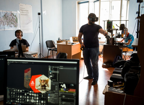 A co-founder of the New Cave Media Polezhaka tests a simulator of virtual reality in his office in Kiev