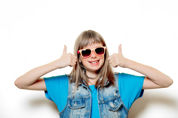 portrait of young teenage girl with sunglasses on white background