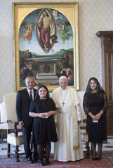 Pope Francis poses with Albanian President Ilir Meta and his doughters Bora and Era during a private audience at the Vatican