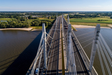 Aerial view of the bridge and the road with cars over the river Rhine in an area of the Netherlands