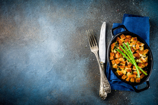 Traditional Thanksgiving, Christmas stuffing in baking pan, dark blue concrete background top view copy space