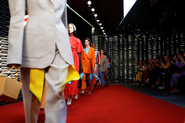 Models present creations at the Roksanda catwalk show at London Fashion Week Women's in London