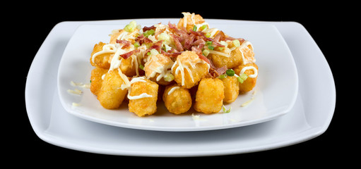 Foto op Plexiglas Buffet, Bar Totchos -Tater tots isolated on black background