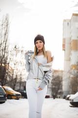 Beautiful young woman posing in winter