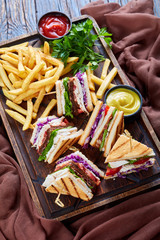Set of club sandwiches on a serving wooden board