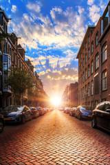 Beautiful early morning sunrise in spring, urban street scene in Amsterdam, the Netherlands