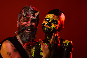 Halloween couple of man devil and woman skull happy smile