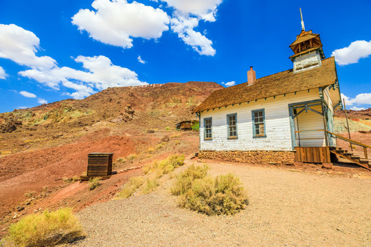 Ancient school house and chapel church in the Calico Mountains of Mojave Desert of Calico old Mining Ghost Town near Barstow in California, USA. Western Cowboy Settlement and Historic Park.