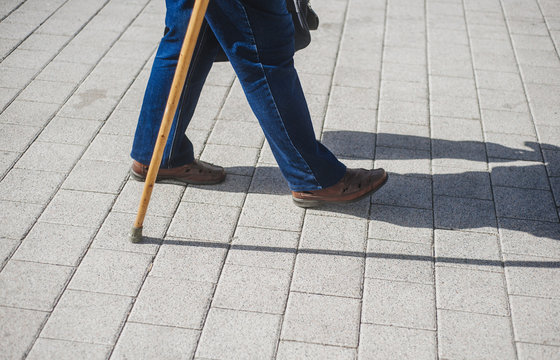 Old man with a cane. Natural. Man with a stick.