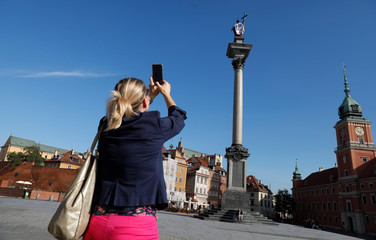 Statue of the King Sigismund at the Old Town is seen dressed up in a T-shirt with the slogan 'Constitution' in Warsaw