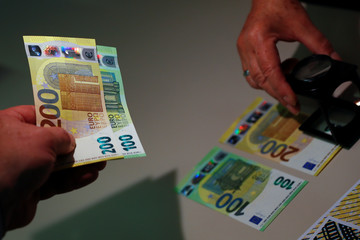 New 100- and 200-euro banknotes are presented at the ECB headquarters in Frankfurt