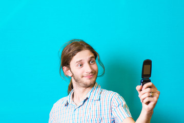 a young man making a funny self phone
