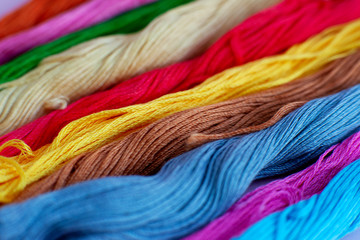 Multicolored thread for embroidery. Macro. Colorful thread stacked in a pile. Embroidery is a kind of needlework and a hobby.
