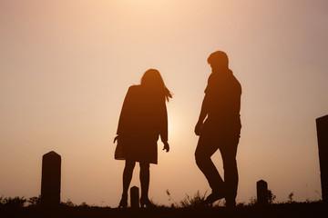 Silhouette of a family enjoying a beautiful sunset