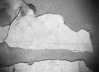 Damaged and peeled cement wall surface. Gray tones. Useful for texture or background.