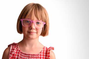 Smiling girl with large and round glasses looking straight ahead