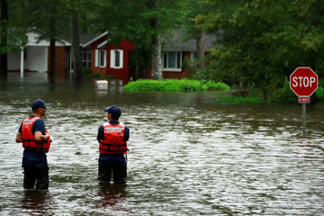 Coast Guard members inspect the flood waters caused by Hurricane Florence in Lumberton.