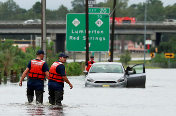 Members of the Coast Guard help a stranded motorist in the flood waters caused by Hurricane Florence in Lumberton.