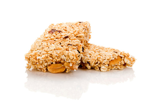 Healthy cereal granola bar with nuts and dry fruit isolated on white background.
