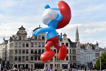 A giant balloon of Papa Smurf floats during the Balloon Day Parade in Brussels