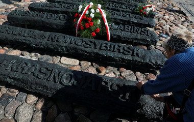 A woman pays her respect to victims, after the ceremony commemorating the 79th anniversary of the Soviet Union's invasion of the eastern part of Poland during the outbreak of World War II, in Warsaw