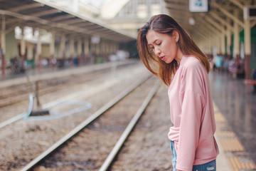 Sad face At the railway platform