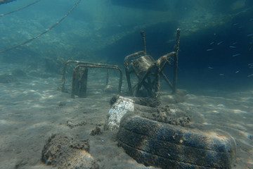 Two chairs are seen at the bottom of the sea off the island of Thasos