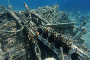 An anchor and other metal waste are seen at the bottom of the sea off the island of Thasos