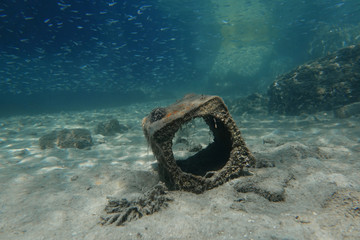 A tin container is seen at the bottom of the sea off the island of Thasos