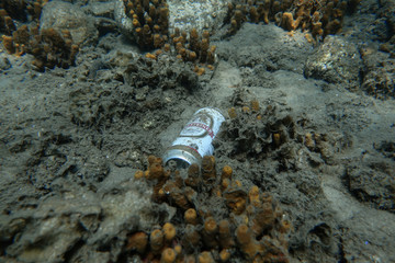 A can of beer is seen at the bottom of the sea off the island of Thasos