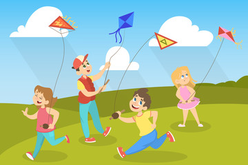 Children in the park playing with colorful kites