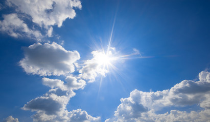 Fototapete - blue sky with clouds and sun reflection.The sun shines bright in the daytime in summer