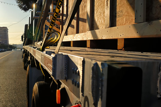 A big rig with a crated load on its flat bed.