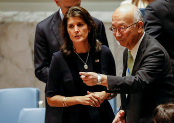 U.S. Ambassador to the United Nations Nikki Haley speaks with Japan's U.N. Ambassador Koro Bessho during a United Nations Security Council meeting about implementation of sanctions against North Korea at U.N. headquarters in New York