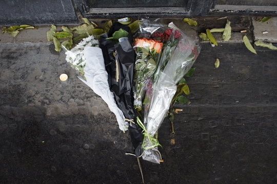 Flowers left on pavement to mark the memory of victims of November 13, 2015, terror attack - Bataclan, Boulevard Voltaire, 75011, Paris