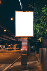 Blank Billboard on City Street at Night.