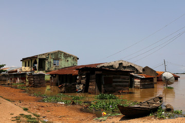 Partially submerged houses are pictured in flood waters in Lokoja city