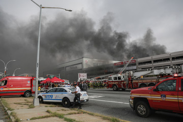 Smoke billows out of the Kings Plaza Shopping Center during a seven-alarm fire in New York