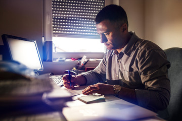 Man working in his office late at night.