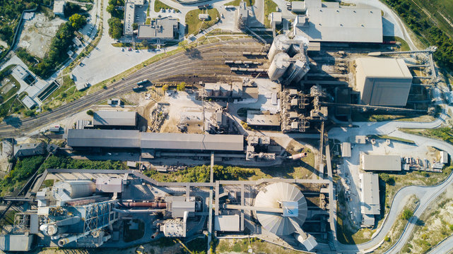 Aerial view of cement manufacturing plant. Concept of buildings at the factory, steel pipes, giants.