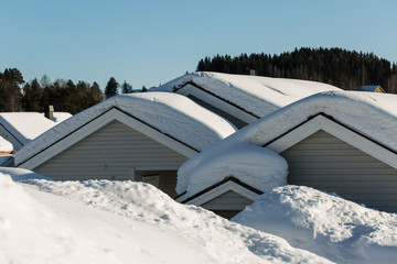 roofs covered with thick snow layer