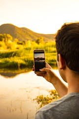 Make a photo of landscape by mobile phone