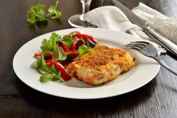 Fried white fish in breadcrumbs with vegetables
