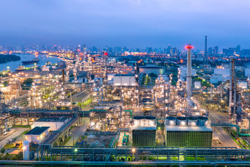 Industrial view at oil refinery plant form industry zone with sunrise and cloudy sky.Oil refinery and Petrochemical plant at dusk,Thailand. Aerial view