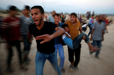 Wounded Palestinian is evacuated during a protest calling for lifting the Israeli blockade on Gaza, near the maritime border with Israel, in the northern Gaza Strip
