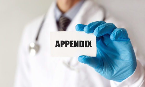 Doctor holding a card with text APPENDIX, Medical concept