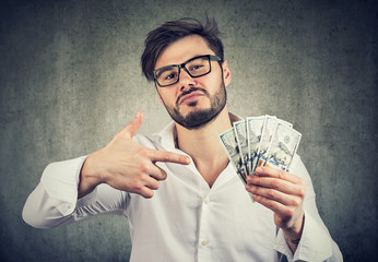 Overconfident man with pile of money