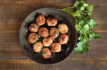 Fried meatballs and fresh parsley